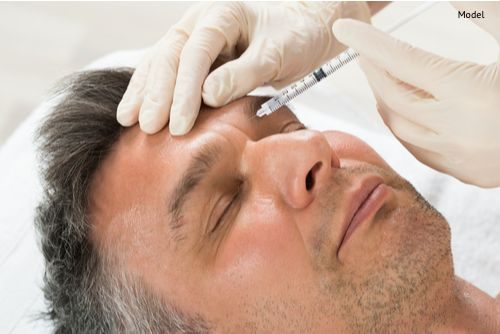 A man receives a cosmetic treatment injection. The stem cell facelift uses stem cell-enriched fat injections to boost facial volume, providing natural rejuvenation and refreshing the appearance.
